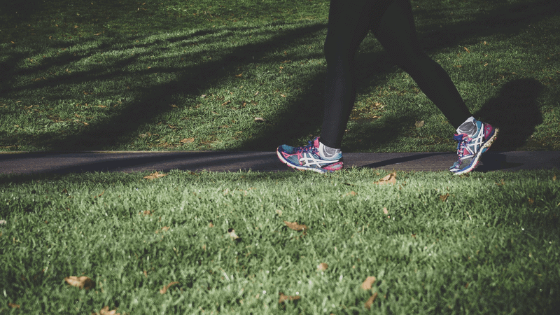 Lady running in a park in London