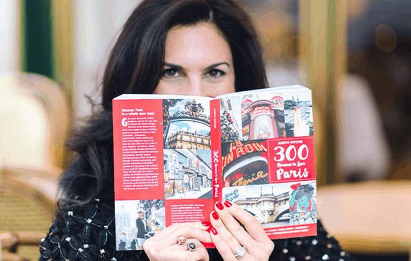 Elisabeth reading a Paris travel book
