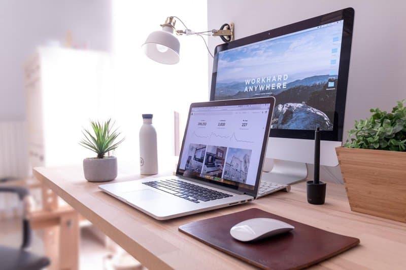 Michelle Seiler Tucker's computer monitors on desk