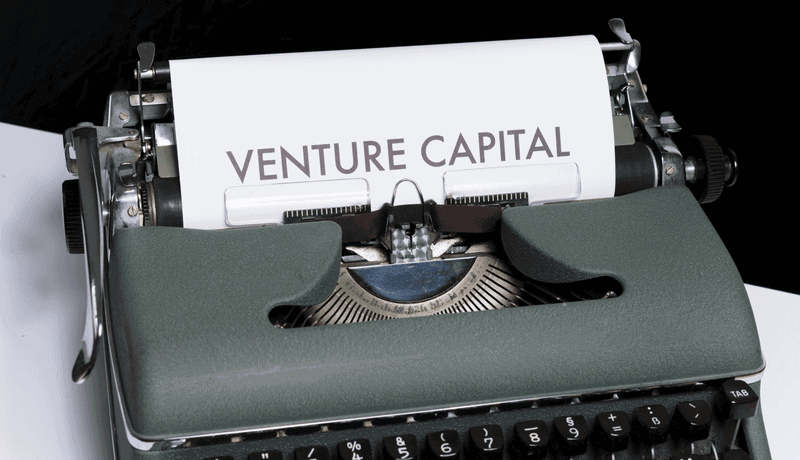 Venture Capital on paper in old typewriter