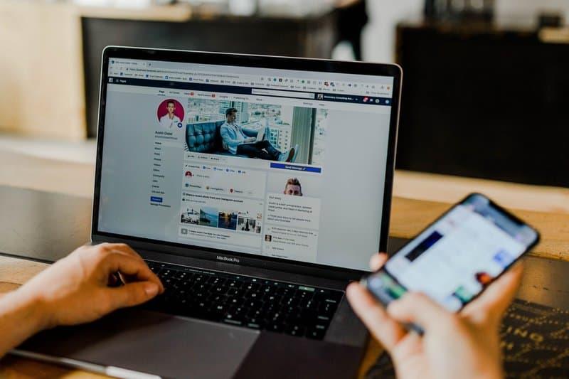 Facebook page of an entrepreneur's social media on desktop and mobile.