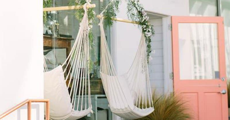nail salon business with white hammock and coral open door